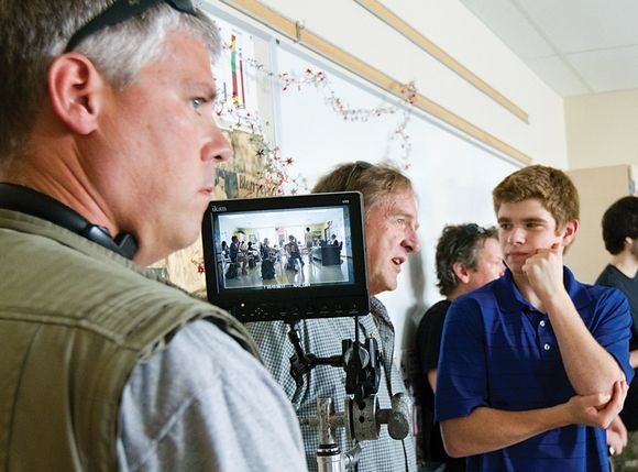 Standing Up Against Child Abuse Writer/director Kevin Gendron, 18, right, speaks with Bill Humphreys, executive director of PPMtv, center, as producer Peter Connors views the framing of a scene during the filming of a public service announcement about child abuse. The 30-second spot was filmed at Portsmouth High School on Saturday. Photo By: Ioanna Raptis